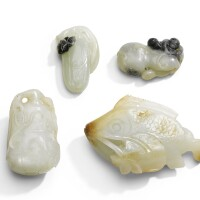 206. a celadon and russet jade fish qing dynasty, 19th century