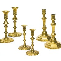 1. three pairs of chippendale brass candlesticks, england and france, 18th century
