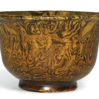 75. an amber-glazed marbled pottery cup tang dynasty