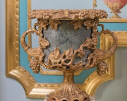 6. a carved giltwood mounted marble campana urn