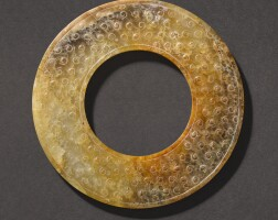 308. a brown and russet jade disc, huan western han dynasty