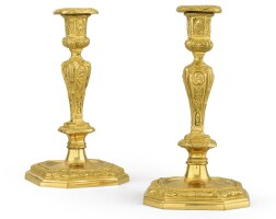 16. a pair of gilt-bronze candlesticks in the french régencestyle  