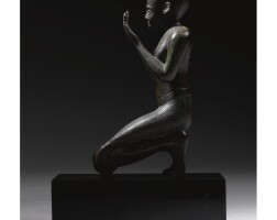 8. an egyptian copper alloy figure of a priest, 26th dynasty, 664-525 b.c.