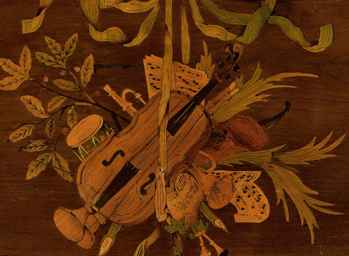 French 18th century table with marquetry design in an auction selling antique french furniture