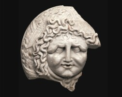 43. a fragmentary roman marble oscillum, circa 1st century a.d. | a fragmentary roman marble oscillum