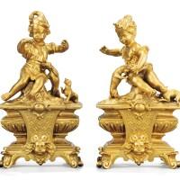 29. a pair of french régence gilt-bronze chenets, circa 1720  