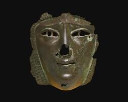 3. a roman bronze female face mask, 2nd/3rd century a.d.