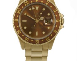 5. rolex | a yellow gold automatic dual time wristwatch with date ref 16718 casen441263 gmt-master ii circa 1991