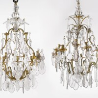 359. a pair of louis xv style gilt bronze and molded glass twenty-two light chandeliers france, late 19th/early 20th century