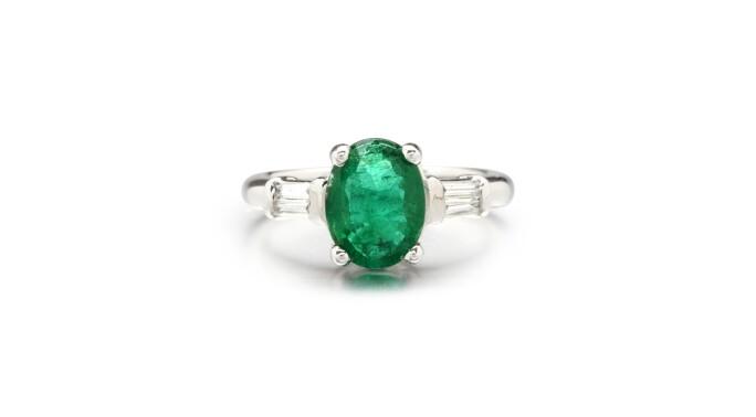 EMERALD AND DIAMOND RING. Estimate £2,600–3,600