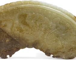 1553. an archaistic celadon and russet jade huang qing dynasty, 19th century  