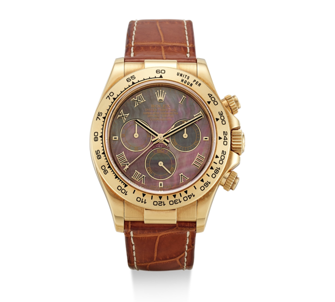 A COSMOGRAPH DAYTONA, REFERENCE 116518, DISPLAYING A VARIATION IN DIAL COLOR. BID NOW.