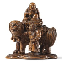 3002. an extremely rare imperialcarved and inscribed boxwood 'manjushri and lion' group seal mark and period of qianlong (dated in accordance with 1761)