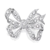 46. 18 karat white gold and diamond brooch