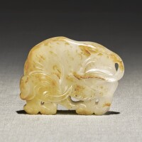 243. a white and russet jade carving of an elephant qing dynasty, 18th century |