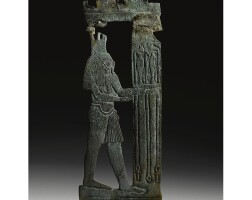 1. an egyptian bronze openwork plaque of a nile god, 26th dynasty, 664-525 b.c.
