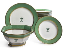 386. a continental porcelain green-bordered monogrammed part dinner service mid-19th century