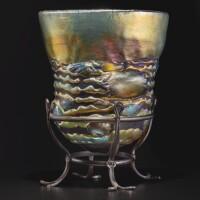 "203. tiffany studios | a rare ""lava"" vase on stand"