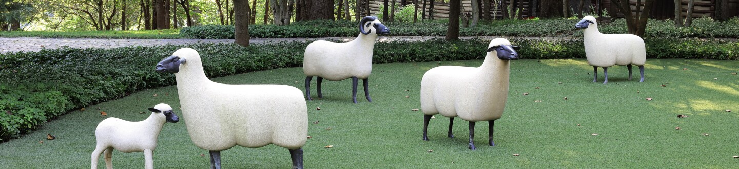 A group of Lalanne sheep in an auction selling Lalanne animal furniture