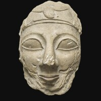 3. a monumental fragmentary cypriote limestone head of a votary, late 7th/early 6th century b.c. | a monumental fragmentary cypriote limestone head of a votary