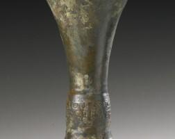 54. an archaic bronze ritual wine vessel (gu) shang dynasty, early yinxu period, 14th-12th century bc
