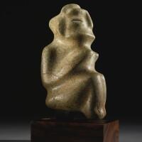 11. chontal stone seated figure, late preclassic, ca. 300-100 b.c.