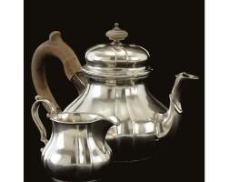 8. a royal german 15-lot standart silver teapot and cream jug, matthias family, hanover, mid 19th century