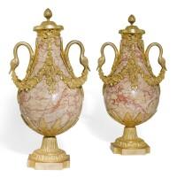 73. a pair of louis xvi stylegilt-bronze mounted figuredmarble urns