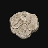 49. a fragmentary roman marble oscillum, circa 1st century a.d.   a fragmentary roman marble oscillum