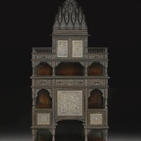 215. a monumental carved rosewood cabinet, india, 19th century