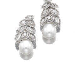 19. pair of cultured pearl and diamond pendent earrings, adler