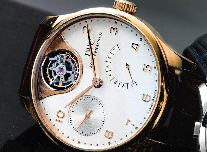 A yellow gold automatic IWC Schaffhausen wristwatch in an auction selling swiss luxury watches