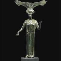 11. a greek bronze mirror handle, 5th century b.c.