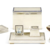 302. an art deco silver-mounted lapis lazuli banded onyx desk set by henry griffith & sons ltd., london, 1921 and 1922 |