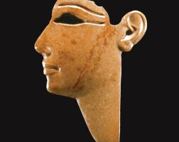 12. an egyptian red jasper inlay of a king or god, 19th/22st dynasty, circa 1290-850 b.c.