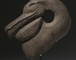 41. maya stone hacha of a pelican head, late classic, ca. a.d. 550-950
