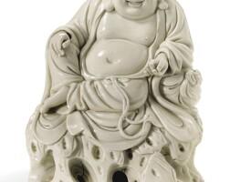 102. a fine dehua figure of budai 17th century