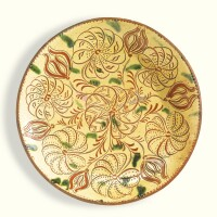 502. rare sgraffito glazed red earthenware plate with pinwheel flowers and tulips, attributed to conrad mumbouer (1761-1845) or john monday (1809-1862) haycock township, bucks county, pennsylvania, 1834-1845