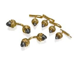 9. 18k yellow gold and hematite dress set