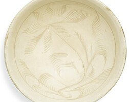 6. a 'cizhou' carved 'floral' bowl song dynasty