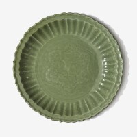 101. a rare large 'longquan' celadon barbed 'pomegranates' dish ming dynasty,late 14th / early 15th century |