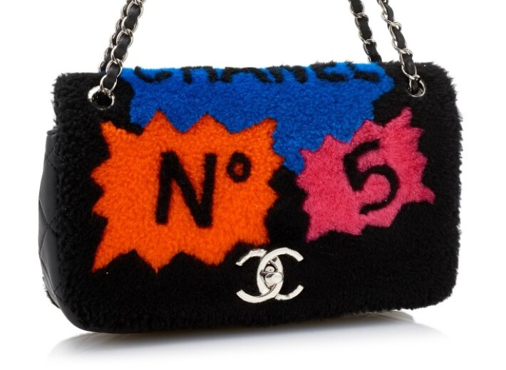 Shearling and leather pop art Chanel bag in an auction selling luxury handbags
