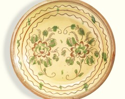 508. rare sgraffito glazed red earthenware plate or deep dish with floral sprays, attributed to david spinner (1758-1811) milford township, bucks county, pennsylvania, 1785-1805