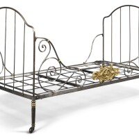 220. a french polished and gilt steel daybed 19th century