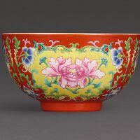 3109. a finely enamelled coral-ground famille-rose bowl seal mark and period of qianlong |