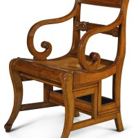 153. a regency oak metamorphic library armchair, circa 1815, after the design by morgan and sanders |