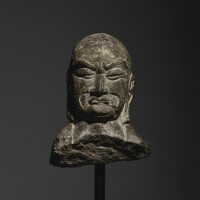 10. a limestone fragmentary relief head of a luohan sui / early tang dynasty |