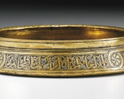 10. a shallow mamluk silver-inlaid brass dish, egypt or syria, 14th century