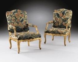 21. a pair of early louis xv carved giltwood armchairs, circa 1730  