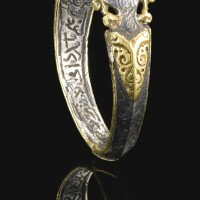 120. a fine and rare seljuk silver and gold ring set with a deep purple stonesealbearing the name of ali ibn yusuf, persia, 12th century